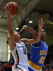 Oregon State guard Gabriella Hanson (11) is fouled by UCLA Bruins guard Kelli Hayes (23) during the second half of an NCAA college basketball game at Oregon State on Sunday, Feb. 12, 2017. Oregon State defeated UCLA 68-61.