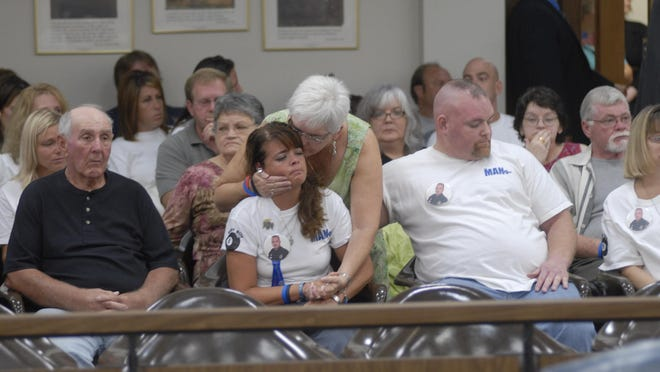 A large crowd, including Trina Evans, center, filles the courtroom during Larry Evans' trial in 2008. Trina Evans has advocated against her brother-in-law being transferred to a less restrictive facility. She maintains he should be held responsible for the death of her husband and his brother, Mansfield Police Officer Brian Evans.