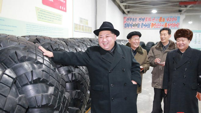 """In this undated photo provided on Sunday, Dec. 3, 2017, by the North Korean government, North Korean leader Kim Jong Un inspects a local tire factory in Chagang Province, North Korea. Kim thanked workers at a factory that built the tires for a huge vehicle used to transport a new intercontinental ballistic missile that was test-launched this week. Independent journalists were not given access to cover the event depicted in this image distributed by the North Korean government. The content of this image is as provided and cannot be independently verified. Korean language watermark on image as provided by source reads: """"KCNA"""" which is the abbreviation for Korean Central News Agency."""