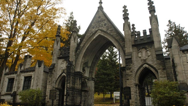 The Gothic archway of 1888 at the main entrance to the Forest Hill Cemetery.