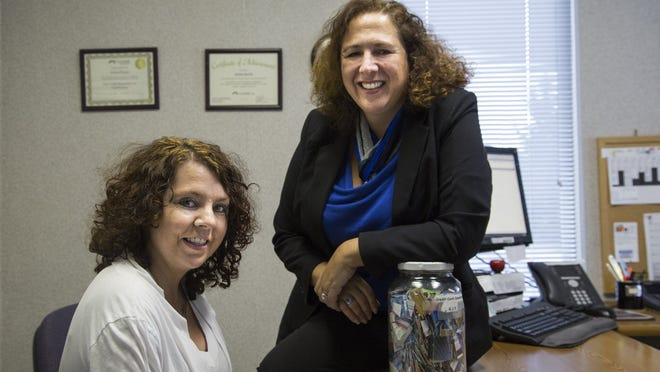 """Tanya LaPrad of Monroe, left, and financial counselor Bettina Bartolo at GreenPath Debt Solutions in Monroe. """"You have to budget everything,"""" LaPrad said. """"I don't spend extra on those extra things like I used to."""""""