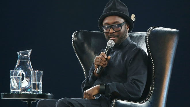 """Will.i.am speaks during a """"fireside chat"""" Tuesday with Salesforce.com Chairman and CEO Marc Benioff at the Indiana Convention Center."""