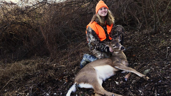 Taylor Howell poses for a photo to send to her grandfather after taking her second deer of the season in Fawn Township Saturday, December 10, 2016. An estimated 333,254 deer were harvested by hunters in the 2016-17 season in Pennsylvania.