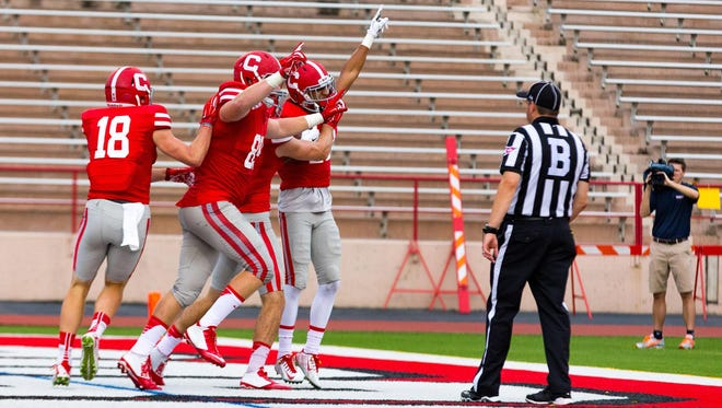 Cornell wide receiver James Hubbard (wearing white gloves) celebrates with teammates after his fourth-quarter touchdown catch last Saturday in the Big Red's 19-14 season-opening loss to Bucknell.