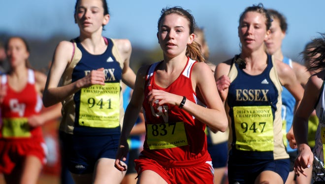 Champlain Valley's Sophia Gorman is flanked by Essex's Emma Farrington, left, and Annemarie Martell during Saturday's high school cross-country state championships in Thetford.