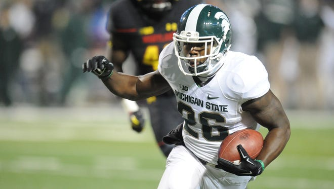 RJ Williamson of Michigan State runs back an interception for a touchdown in the third quarter.