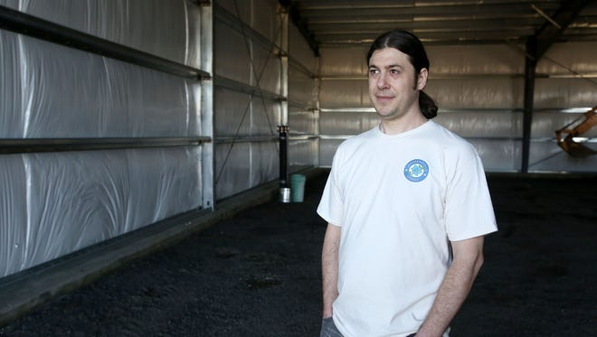 Brian Humiston, who owns Full Circle Creamery with his wife, Kate, poses for a photo in a building where they hope to house their new creamery.