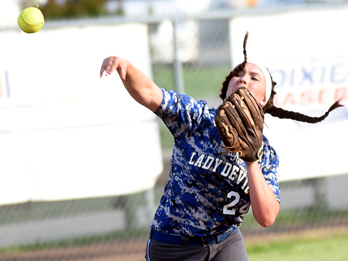 White House High senior shortstop Savannah Fuston throws to first base for a third-inning putout during Wednesday evening's 7-2 win over Westmoreland.