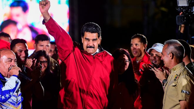 "Venezuelan President Nicolas Maduro celebrates the results of Sunday's vote for a ""Constituent Assembly"" in Caracas on July 31, 2017."