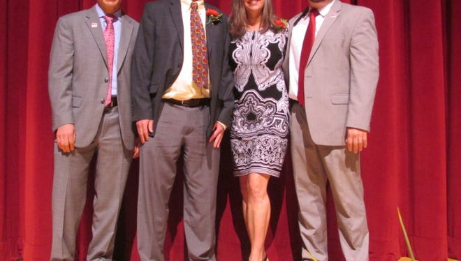 Rancocas Valley High School's Superintendent Christopher Heilig (left), RV Teacher of the Year Ed Moore, Educational Services Professional of the Year Dee Venuto, and Rancocas Valley principal Joseph Martin celebrate at the Burlington County Educators of the Year program on May 17.