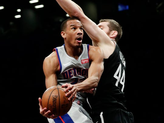 Detroit Pistons' Avery Bradley (22) drives past Brooklyn Nets' Tyler Zeller (44) during the first half of an NBA basketball game Wednesday, Jan. 10, 2018, in New York.