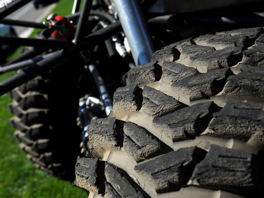 "A worn tire on Jesse Haines' ""rock crawler"" is seen in the Summit Racing parking lot in Sparks on Sept. 19, 2015."