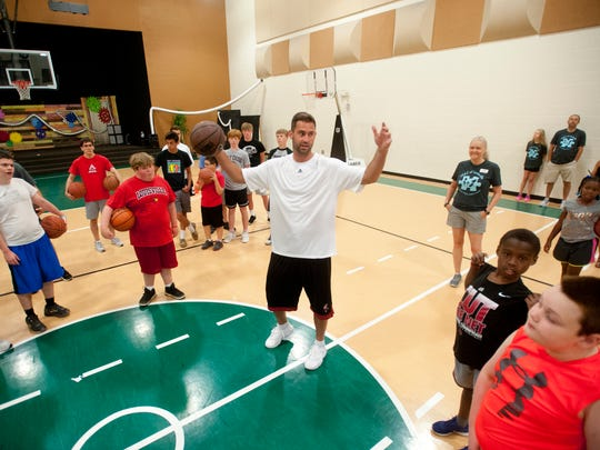 Former U of L basketball player Luke Hancock tells participants in a FEAT (Families for Effective Autism Treatment) of Louisville basketball clinic, what they will be doing. 15 July 2017