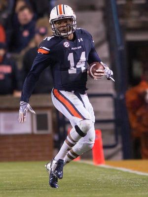 Auburn quarterback Nick Marshall (14) runs down the sideline during the NCAA football game on Saturday, Nov. 22, 2014, at Jordan-Hare Stadium in Auburn, Ala.
