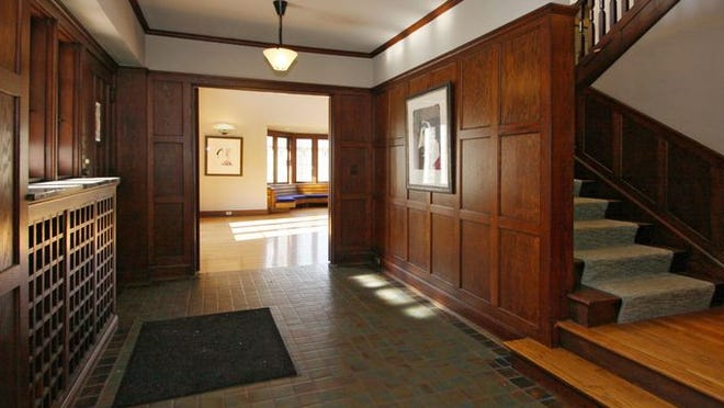 The foyer of the 1923 home welcomes guests with its Arts & Crafts style.