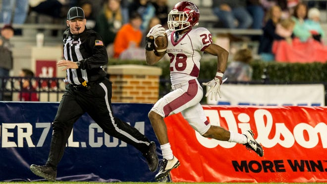 Maplesville's Terence Dunlap take off for a long touchdown run during the second half of the AHSAA Super 7 Class 1A high school football championship game, between Maplesville and Cedar Bluff, Thursday, Dec. 3, 2015, at Bryant-Denny Stadium in Tuscaloosa, Ala. (Vasha Hunt/AL.com via AP) MANDATORY CREDIT