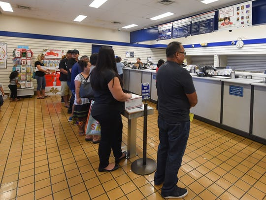 Customers line up for postal transactions at the U.S. Post Office in Barrigada in this Nov. 20, 2017, file photo.