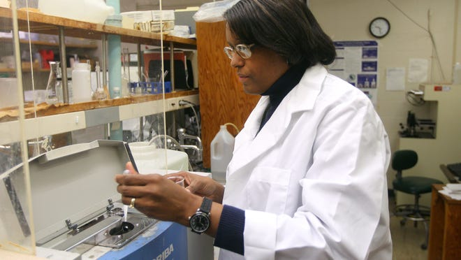 Kodak scientist Valerie Turner works in a particle technology lab on a process to be used in a partnership with PurThread Technologies Inc.
