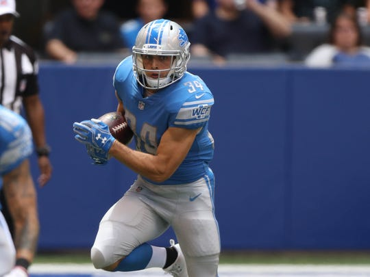 Zach Zenner runs the ball against the Colts in the second quarter Aug. 13, 2017 at Lucas Oil Stadium in Indianapolis.