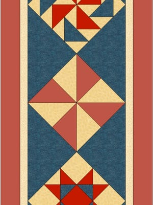 An image of the table runner used to teach triangle construction in Quilt 102