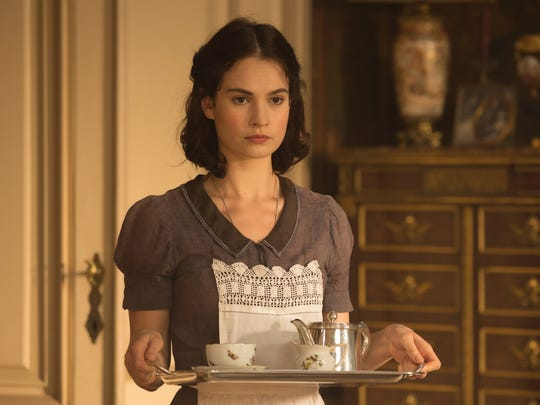 Mieke (Lily James), the Kaiser's maid, is secretly