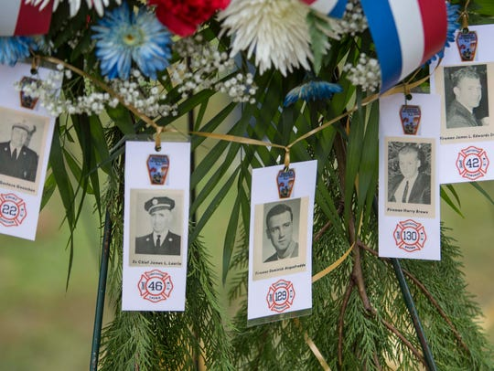 A wreath adorned with pictures of the five deceased