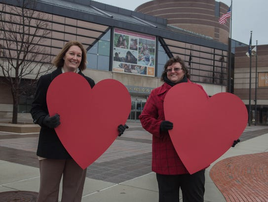 Kathy Carlin, left, and Lori Perez stand in front of