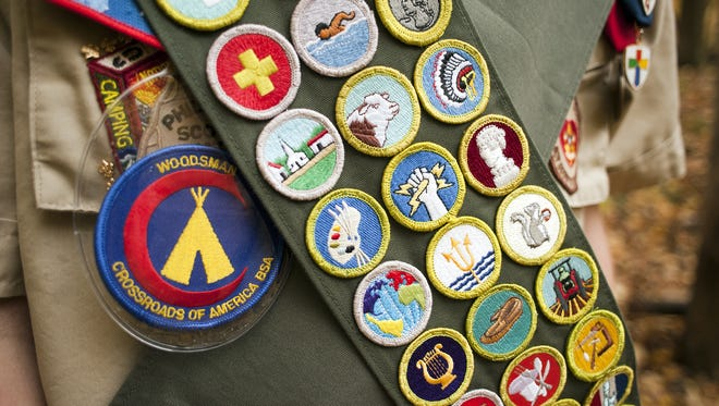 An Eagle Scout displays the 133 merit badges awarded to him by the Boy Scouts of America.