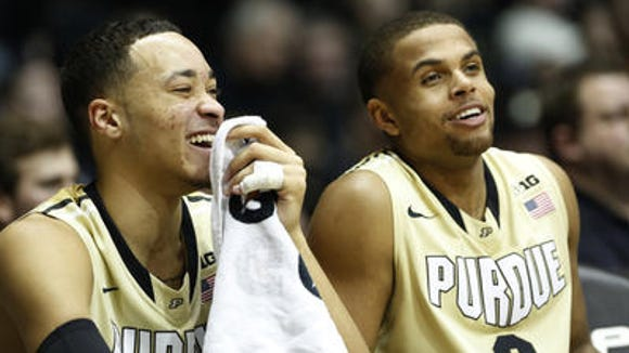 Kendall Stephens and P.J.Thompson enjoy Wednesday's 83-67 victory over Indiana from the bench.