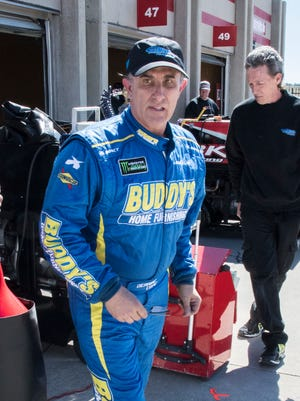 Driver Derrike Cope leaves the garage Friday after practice for the NASCAR Cup Series race at Atlanta Motor Speedway.