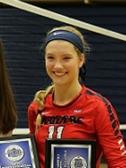 Shippensburg freshman Morgan DeFlorio, right, accepts the MVP award after helping Shippensburg win the PSAC Championship in women's volleyball.