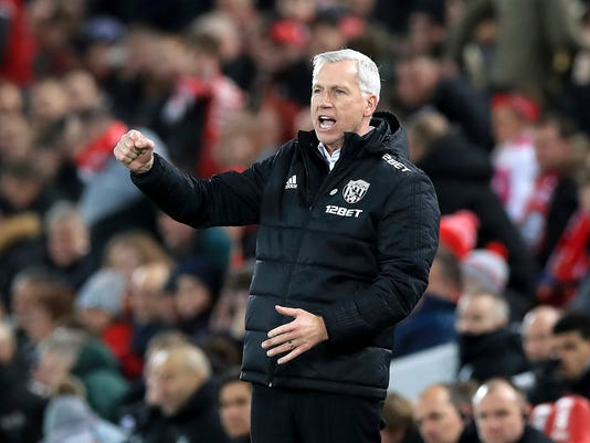 West Bromwich Albion manager Alan Pardew celebrates after the final whistle of the English FA Cup, fourth round soccer match between Liverpool and West Bromwich Albion, at the Anfield stadium, Liverpool, England, Saturday Jan. 27, 2018.West Bromwich Albion defeated Liverpool 3-2. (Peter Byrne/PA via AP)