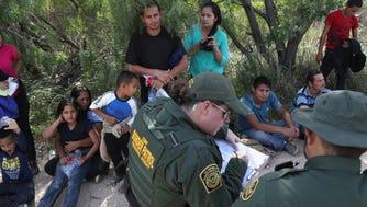 Border Patrol agents take migrants into custody on June 12, 2018, near McAllen, Texas.