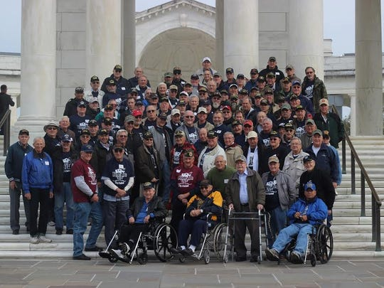 """Saturday, November 18, 2017--Over 100 veterans of the WW II, Korean War, and Vietnam War eras gathered at Northeastern High School for the 12th Honor Bus trip.  This day of """"Gratitude and Thanks"""" was sponsored by the Northeastern High School Honor Bus Project.  This group of students has taken upon itself the challenge of escorting our local veterans on an all-expenses paid trip to Washington DC to visit the various memorials dedicated to their service. While in Washington veterans also visited Arlington National Cemetery to witness the changing of the guard at the Tomb of the Unknowns.  submitted photo"""