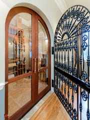 Able to house over 1,000 bottles of vino in its Mahogany