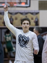 Matt Harshany (14) warms up prior to the basketball