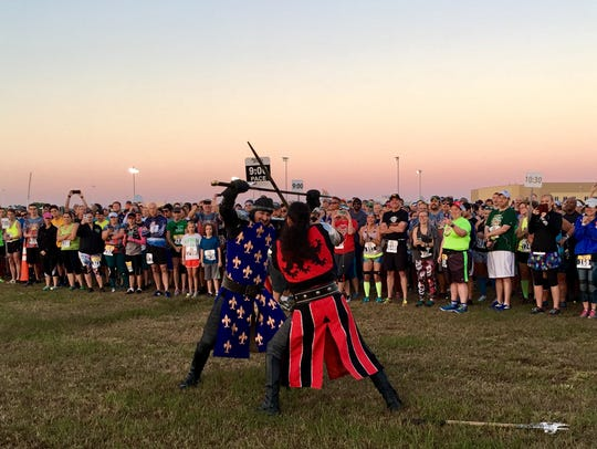 """Knights"" from Medieval Times start the 2018 Excalibur 10 Miler."