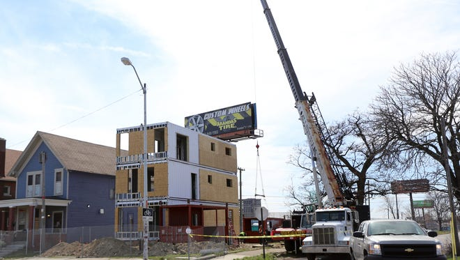 The Three Squared shipping container housing project in North Corktown under construction in April.