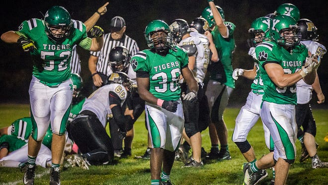 Yorktown's defense stops a run by Peru during their sectional game at Yorktown High School Friday, Oct. 23, 2015.