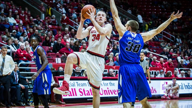Ball State's Sean Sellers looks to shoot past Indiana State's defense during their game at Worthen Arena Tuesday, Nov. 15, 2016.