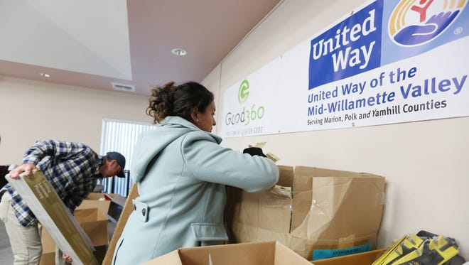 Mike Ganchenko of Northwest Human Services and Nidia Wheeler of Hope on the Hill collect goods for their nonprofits as part of Good360 on Tuesday, March 29, 2016, at United Way of the Mid-Willamette Valley in Salem. Good360 is a partnership that allows the United Way to obtain retail goods from local businesses and redistribute them to nonprofit agencies in the community.