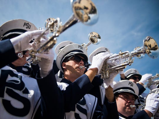 Trumpet players warm up outside the Blue Band Building in State College before Penn State's Sept. 26 game against San Diego State.
