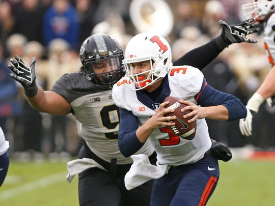 Lorenzo Neal of Purdue chases down Illinois quarterback Jeff George Jr. in the second quarter Saturday, November 4, 2017, at Ross-Ade Stadium.