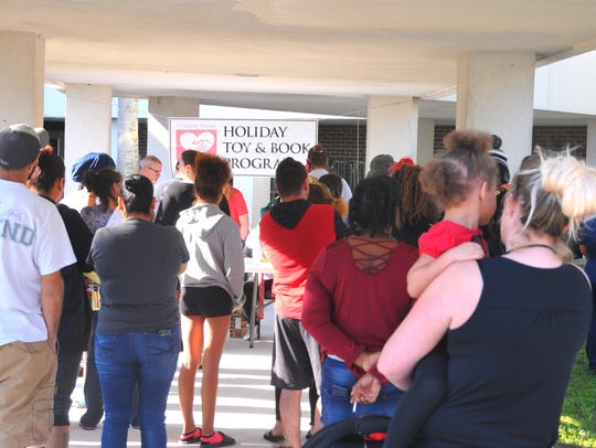 People line up on the Eastern Florida State College
