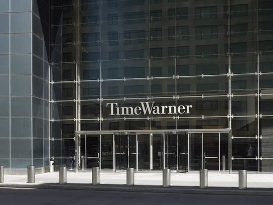 A view of the entrance to the Time Warner Center in New York City. Time Warner will be an essential part of helping AT&T continue to grow its dividend payments.