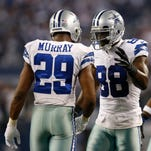 Dallas Cowboys running back DeMarco Murray (29) celebrates with receiver Dez Bryant (88) after scoring a touchdown against the Detroit Lions during the third quarter in the NFC Wild Card Playoff Game at AT&T Stadium.
