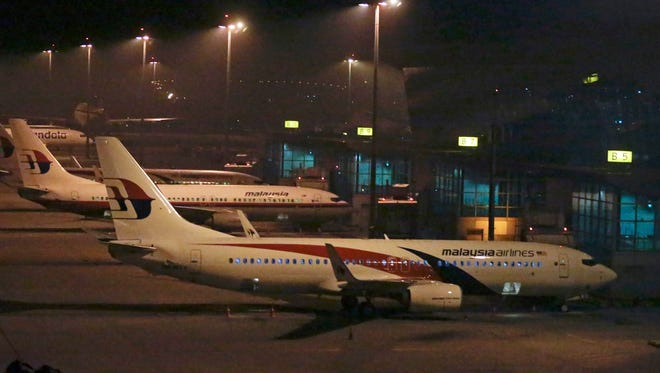 Malaysia Airlines aircraft parked at Kuala Lumpur International Airport in Sepang outside Kuala Lumpur, Malaysia, on 18 May 2014. Malaysia Airlines lost contact with Flight MH17 at 5:15 pm (1415 GMT), about 50 kilometres from the Russia-Ukraine border, the airline said in a statement. The Boeing 777 departed Amsterdam at 12:15 pm and was scheduled to arrive in Kuala Lumpur at 6:10 am 18 July. The plane was carrying 280 passengers and 15 crew members, the statement said.
