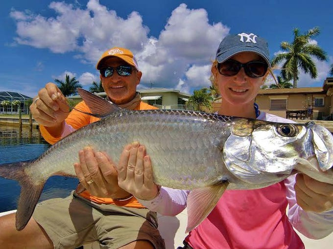 Teresa Spano with her father, Don, and her first tarpon,