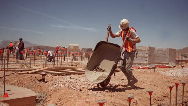 Kirk Eisaman works on the construction site of the new Damonte High School in 2002. The school is now overcrowded and will receive an addition in 2017. o o o Photo by: Liz Margerum Kirk Eisaman moves a wheel barrow at the construction site of the new Damonte High School in south Reno. Q&D Construction Inc. of Reno received the prestigious Golden Hard Hat award from the Nevada Chapter Associated General Contractors.