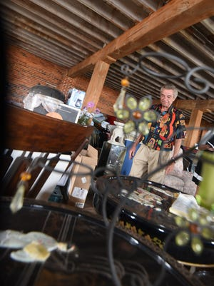 Mick Tridico looks through some of the many treasure available at City Mills Building.